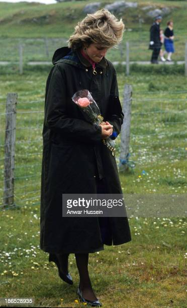 Diana, Princess of Wales, wearing a Barbour waxed jacket, holds a bouquet during a visit to Lochmaddy on July 4, 1985 in the Outer Hebrides, Scotland.