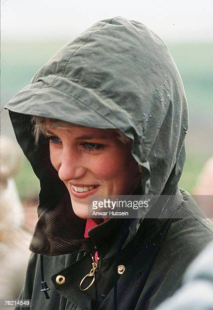 Diana, Princess of Wales, wearing a Barbour waxed jacket with the hood up, during a visit to Lochmaddy on July 4, 1985 in the Outer Hebrides,...