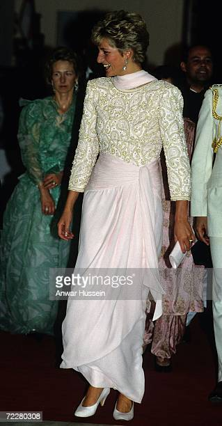 Diana Princess of Wales wears a Catherine Walker sarong style evening dress in pink chiffon in October 1991 during her visit to Pakistan