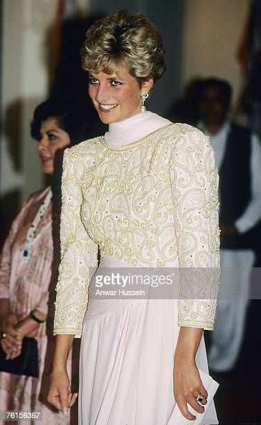 Diana Princess of Wales wears a Catherine Walker sarong style evening dress in pink chiffon during her visit to Pakistan in October 1991 in Pakistan