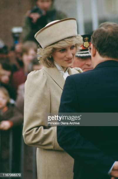 Diana, Princess of Wales wearing a beige Caroline Charles coat during a visit to Derby, UK, February 1985.