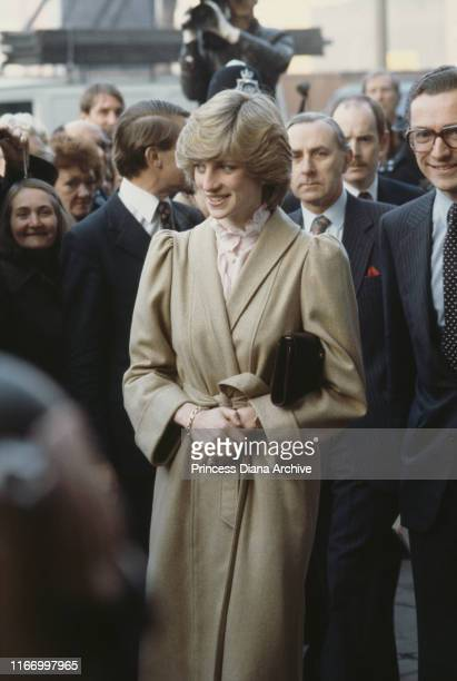 Diana, Princess of Wales wearing a beige coat by Caroline Charles during a visit to the DHSS office in Wandsworth, London, December 1982.