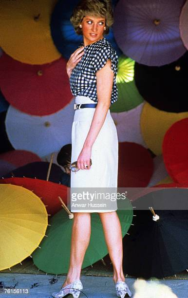 Diana Princess of Wales poses with umbrellas in Thailand in 1988
