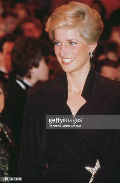 Diana Princess of Wales wearing a black cocktail dress with a star ornament to the Laurence Olivier Awards at the Dominion Theatre in London 29th...