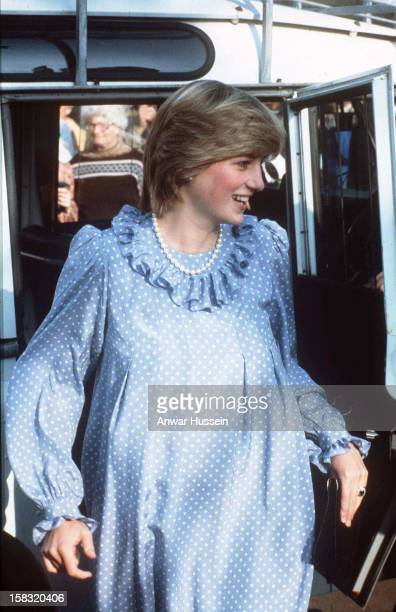 Diana, Princess of Wales, wearing a blue and white polka dot maternity dress with a ruffled collar designed by Catherine Walker, during a walkabout...
