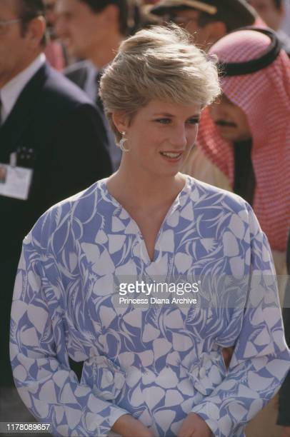 Diana, Princess of Wales wearing a blue and white suit by Catherine Walker to a picnic in the desert near Riyadh, Saudi Arabia, November 1986. She is...