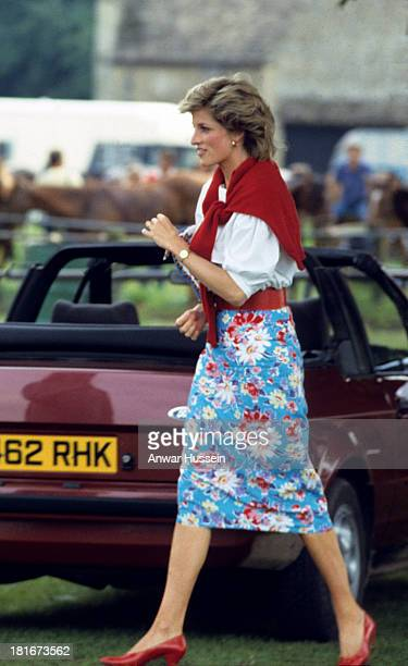 Diana Princess of Wales wearing a blue flowered skirt and white blouse attends a polo match at Cirencester Park on June 30 1985 in Cirencester England