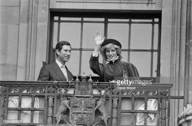 Diana Princess of Wales wearing a Caroline Charles outfit with a hat by John Boyd and Charles Prince of Wales waving from the balcony of Nottingham...