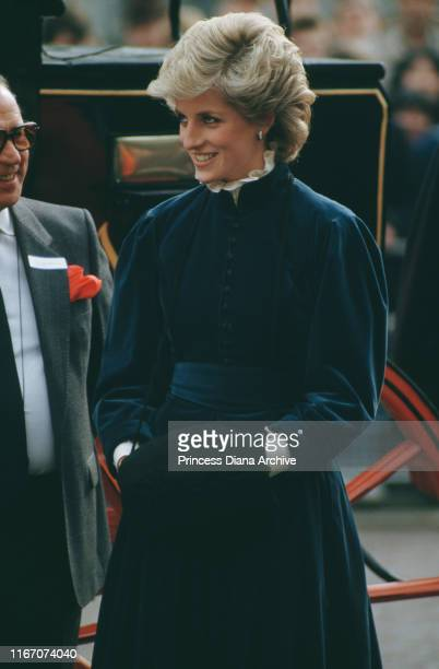 Diana Princess of Wales wearing a Caroline Charles velvet suit and a muff during a visit to Cardiff in Wales March 1986