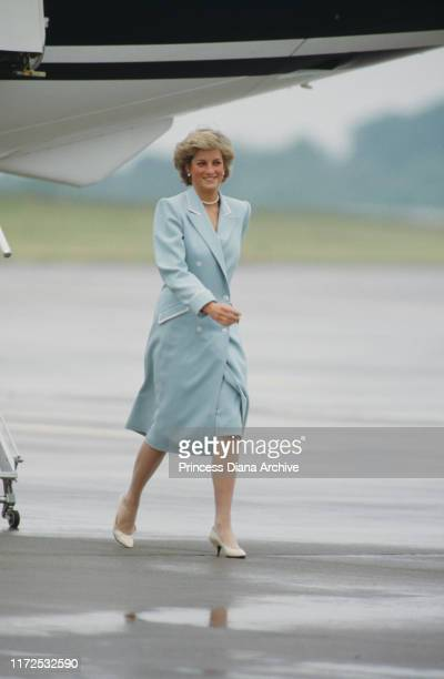 Diana, Princess of Wales wearing a Catherine Walker coat upon her arrival at Huddersfield airport, UK, July 1987.