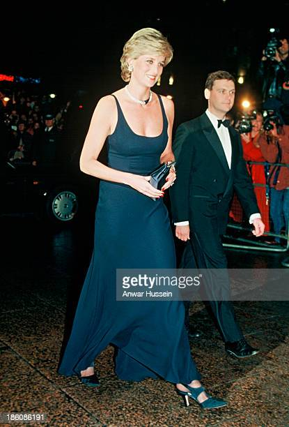 Diana Princess of Wales wearing a Catherine Walker evening dress and jewels that were a gift from the Sultan of Oman arrives for the film premiere of...