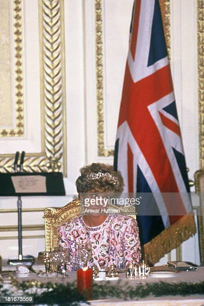 Diana Princess of Wales wearing a Catherine Walker gown and the Spencer family tiara looks unhappy during an official banquet on November 03 1992 in...