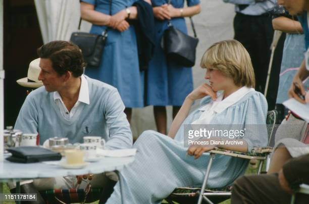 Diana, Princess of Wales wearing a Catherine Walker maternity dress at a polo match in Brockenhurst, Hampshire, May 1982. Prince Charles is on the...