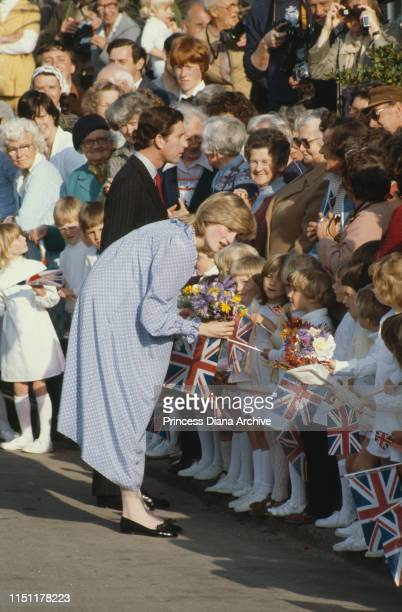 Diana Princess of Wales wearing a Catherine Walker maternity dress at St Mary's on the Isles of Scilly April 1982 Prince Charles is on the left