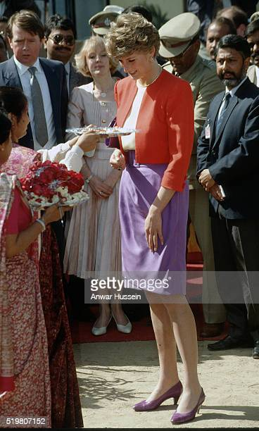 Diana Princess of Wales wearing a Catherine Walker red and purple outfit visits Agra during a visit to India on February 11 1992 in Agra India