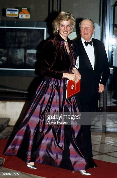 Diana Princess of Wales wearing a Catherine Walker tartan evening gown arrives for a charity function at the Guildhall on February 18 1991 in London...