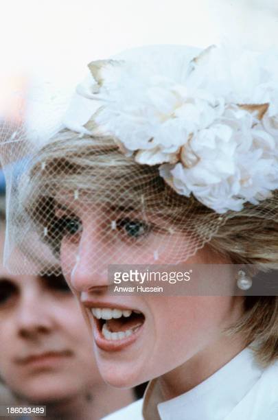 Princess Diana Princess of Wales wearing a John Boyd hat with a veil smiles during a tour of Australia on March 31 1983 in Tasmania Australia