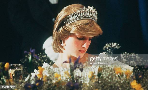 Diana Princess of Wales wearing a cream satin dress by Gina Fratini with the Queen Mary Tiara attends a banquet at Hotel Nova Scotian on June 15 1983...