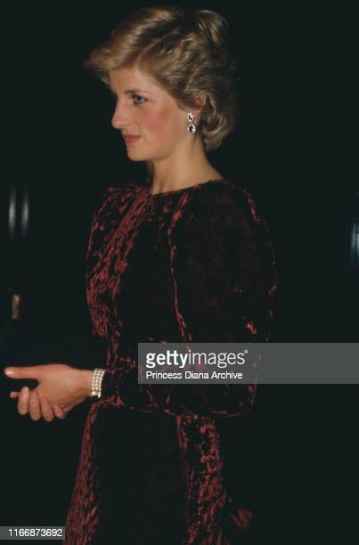 Diana Princess of Wales wearing a crushed velvet gown by Catherine Walker to a concert at the Barbican Centre in London November 1985
