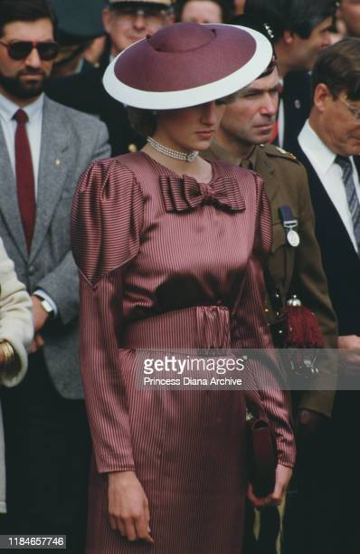 Diana, Princess of Wales wearing a dress by Catherine Walker during a visit to the World War II cemetery in Anzio, Italy, April 1985.