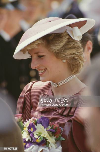 Diana Princess of Wales wearing a dress by Catherine Walker during a visit to the World War II cemetery in Anzio Italy April 1985