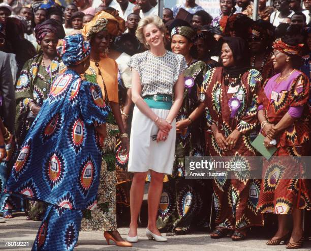 Diana, Princess of Wales, wearing a dress designed by Alistair Blair, speaks to Maryam Babangida , the wife of the Nigerian president General Ibrahim...