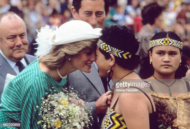 Princess Diana Princess of Wales greets a Maori woman with a traditional hongi nose rub at the Eden Park Stadium on April 18 1983 in Auckland New...
