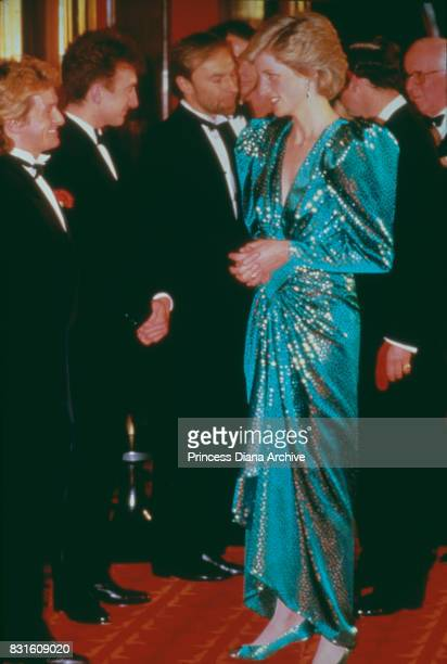 Diana Princess of Wales wearing a emerald green sequin gown by Catherine Walker attends the film premiere of 'Biggles' at the Plaza Cinema on Lower...
