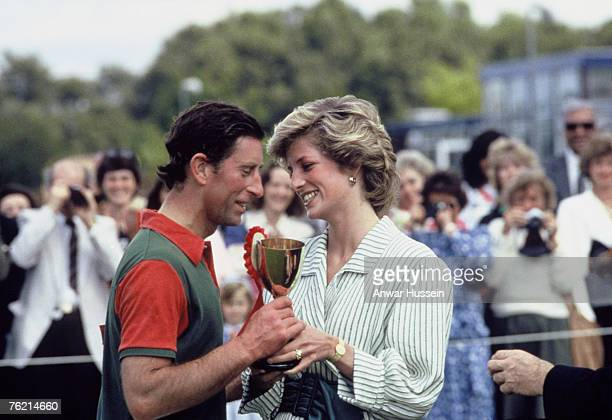 Diana, Princess of Wales presnets Prince Charles, Prince of Wales with an award following a charity polo match at Windsor Great Park on June 29, 1985...
