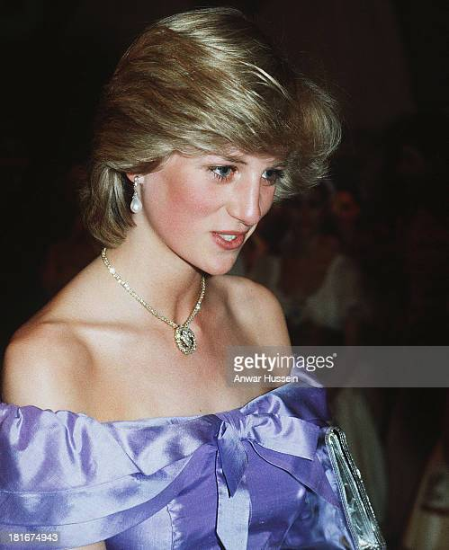 Diana Princess of Wales wearing a mauve Donald Campbell gown and Prince of Wales feathers necklace attends the ballet 'Copella' on April 18 1983 in...