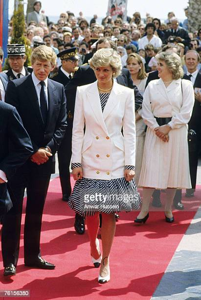 Diana wears Catherine Walker dress with a puffball skirt together with a double breasted white blazer at the Cannes film festival in 1987