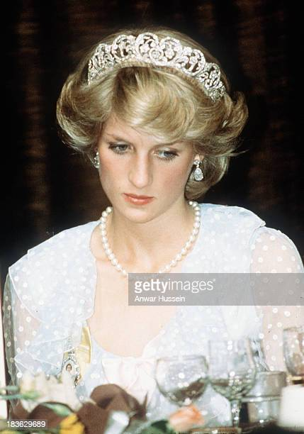 Diana, Princess of Wales, wearing a pale blue dress with polka dots designed by Elizabeth and David Emanuel and the Spencer family tiara, attends a...