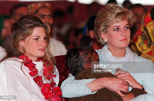 The Princess of Wales cradles a sick child in her arms while she sits with Jemima Khan during her visit to the former Pakistani cricket captain Imran...