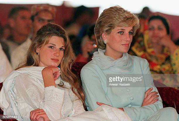Diana, Princess of Wales, wearing a pale blue shalwar kameez, sits next to Jemima Khan during a visit to Shaukat Khanum Hospital on February 22, 1996...