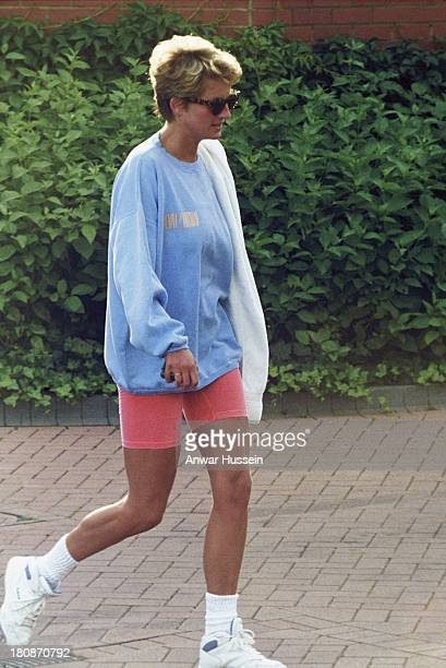 Princess Diana Princess of Wales wearing a sweatshirt and shorts leaves Chelsea Harbour Club on August 01 1998 in London England