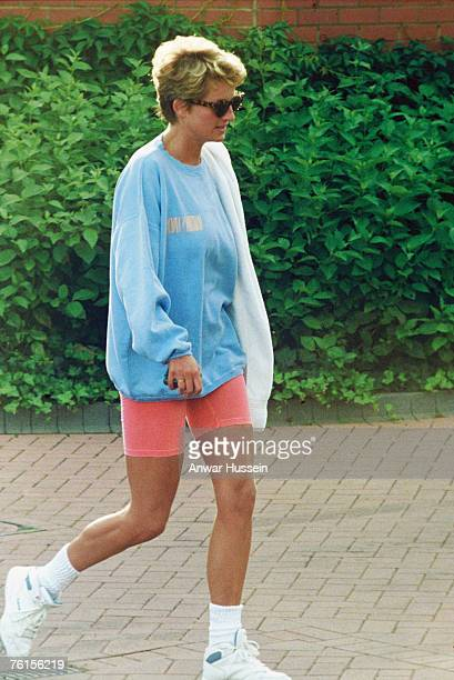 Princess Diana in shorts and tennis shoes arriving at her sports club in London, England.
