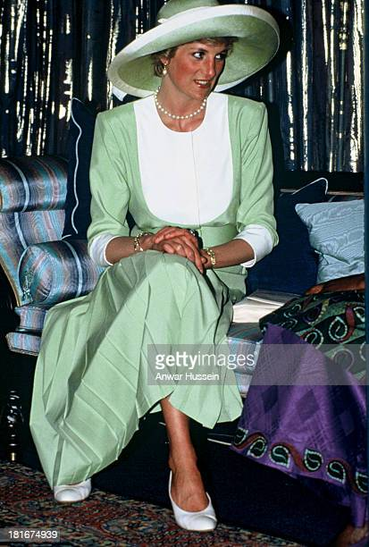 Diana Princess of Wales wearing a green Catherine Walker outfit and Philip Somerville hat visits Nigeria on March 15 1990 in Lagos Nigeria