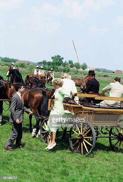 Princess Diana jumps off a horsedrawn cart during a visit to Hungary in May 1990