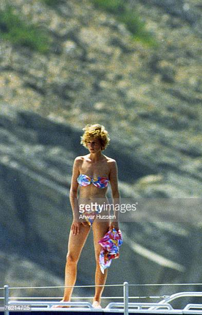 Diana, Princess of Wales, wearing a patterned bikini and holding a matching sarong, stands on board a yacht, whilst on holiday on August 16, 1988 in...