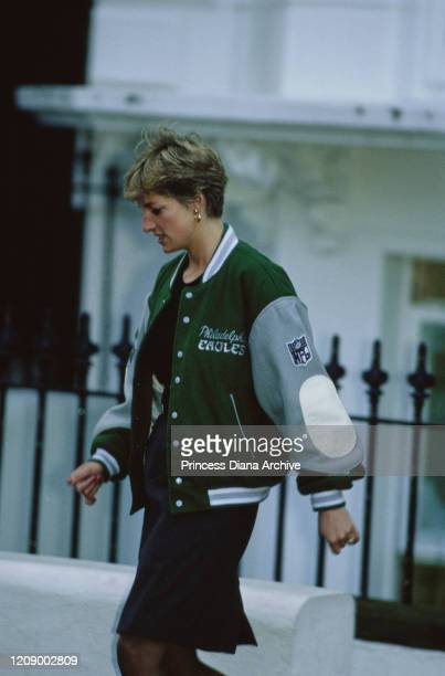 Diana, Princess of Wales wearing a Philadelphia Eagles jacket to drop off her son Prince Harry at Wetherby School in London, January 1991.