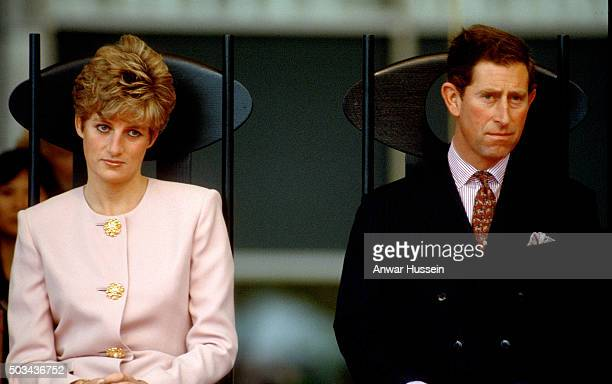 Prince Charles Prince of Wales and Diana Princess of Wales look unhappy at the start of a Tour of Canada on October 25 1991 in Toronto Canada
