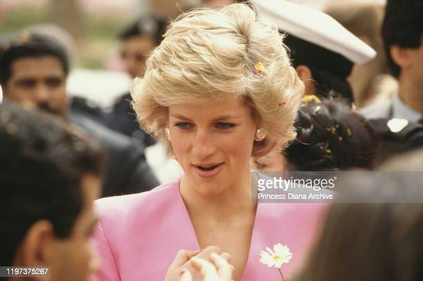 Diana, Princess of Wales wearing a pink and red coat-dress by Catherine Walker in Kuwait City, Kuwait, March 1989.
