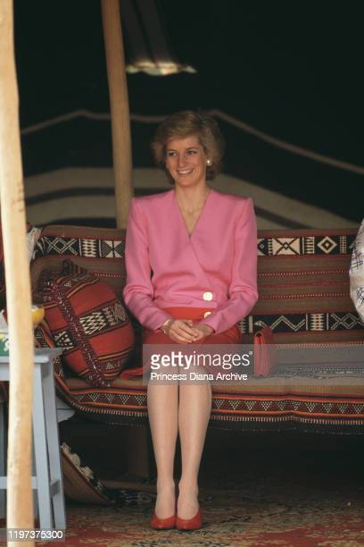 Diana, Princess of Wales wearing a pink and red coat-dress by Catherine Walker during a visit to the museum in Kuwait City, Kuwait, March 1989.