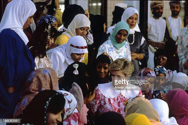 Diana Princess of Wales wearing a pink and white dress by Paul Costello meets female students at Oman University on November 01 1986 in Oman