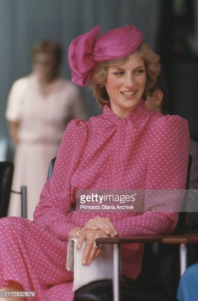 Diana, Princess of Wales wearing a pink Donald Campbell suit and a John Boyd hat at the Perth Hockey Stadium in Bentley, Australia, 7th April 1983.