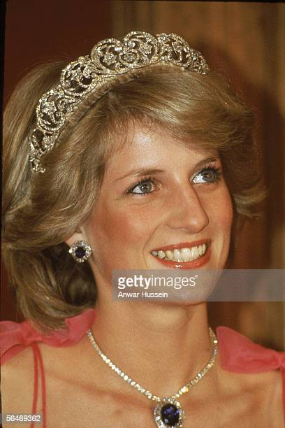 Princess Diana wears the Spencer Family diamond Tiara with a suite of sapphire and diamond jewellery including a pendant matching earrings given as a...