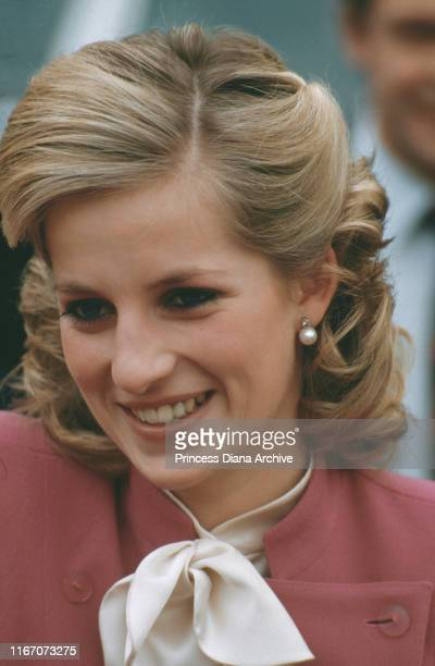 Diana, Princess of Wales wearing a pink Jasper Conran suit and a new hairstyle during a visit to Ealing, London, November 1984.