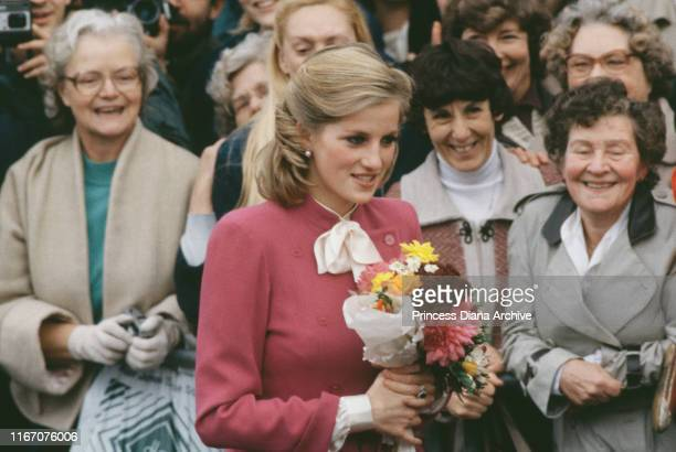 Diana Princess of Wales wearing a pink Jasper Conran suit and a new hairstyle during a visit to Ealing London November 1984