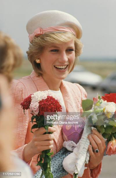 Diana, Princess of Wales wearing a pink suit by Bruce Oldfield during a visit to Coventry, UK, July 1986.