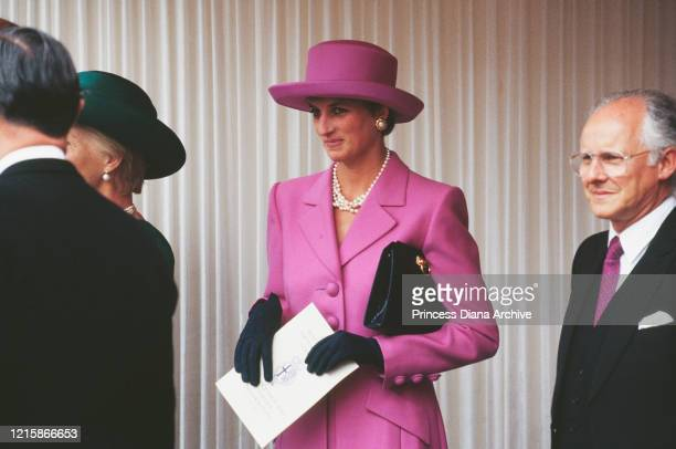 Diana, Princess of Wales , wearing a pink wool suit by Catherine Walker, with dark gloves and hat by Philip Sommerville, attends the Order of the...